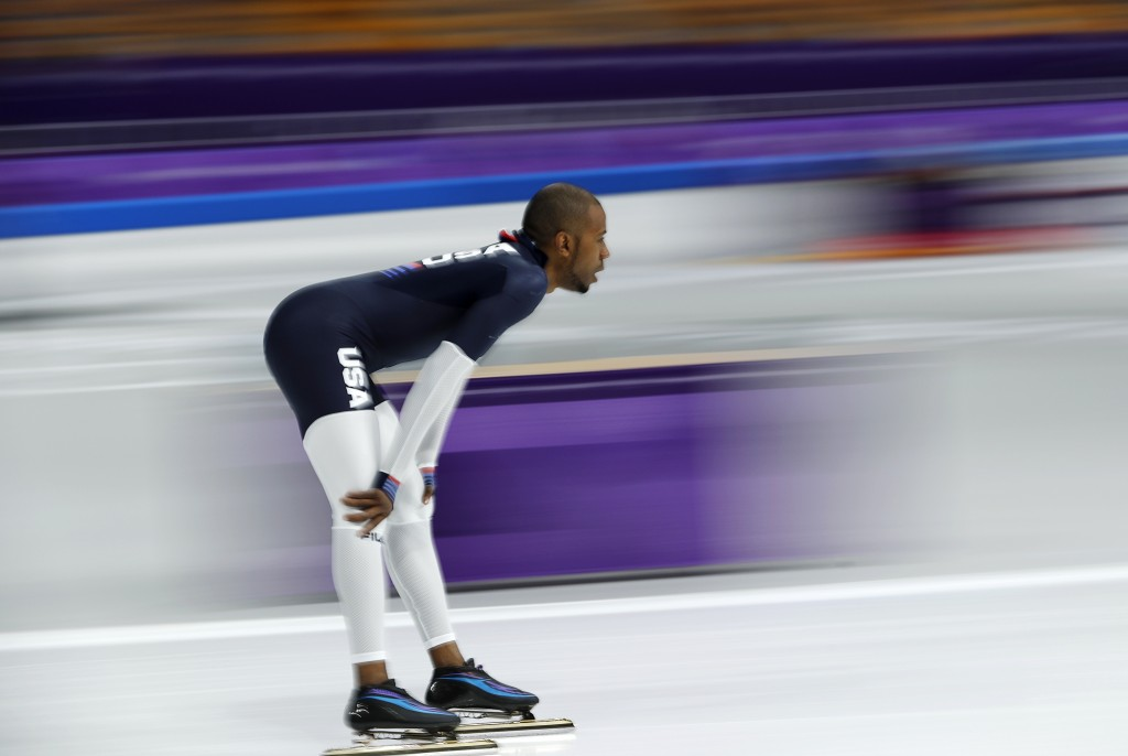 Shani Davis if the U.S. rides warm-up laps prior to the men's 1,500 meters speedskating race at the Gangneung Oval at the 2018 Winter Olympics in Gang