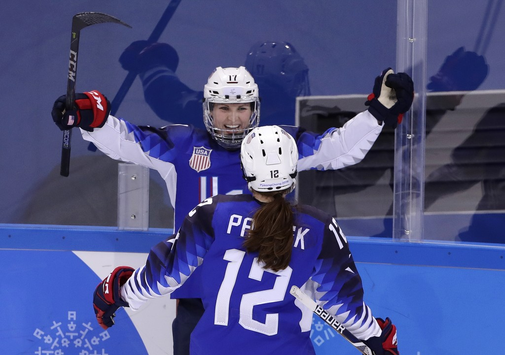 Jocelyne Lamoureux-Davidson (17), of the United States, celebrates her second goal against the team from Russia with Kelly Pannek (12) during the seco