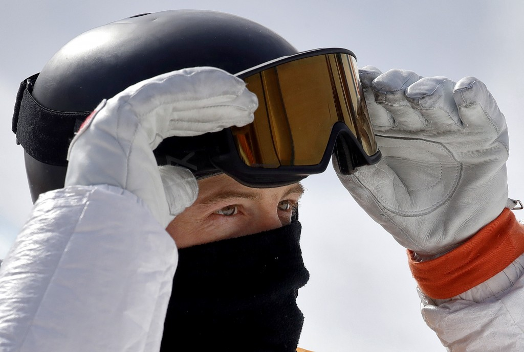 Shaun White, of the United States, looks at his score during the men's halfpipe qualifying at Phoenix Snow Park at the 2018 Winter Olympics in Pyeongc