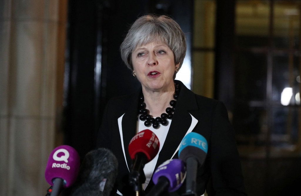 Britain's Prime Minister Theresa May speaks outside Stormont House in Belfast, following a bilateral meeting with Irish counterpart Leo Varadkar after