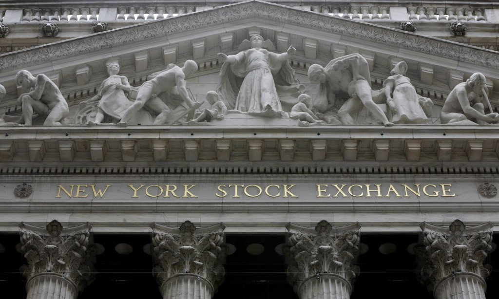 FILE - This Oct. 4, 2014, file photo, shows the facade of the New York Stock Exchange. Health care companies are leading stocks broadly lower in early