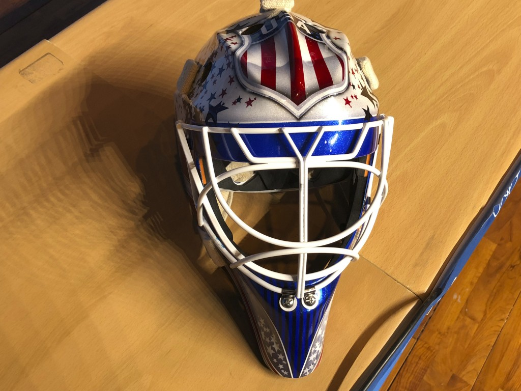 In this Monday, Feb. 12, 2018 photo, the mask of United States men's hockey goaltender Brandon Maxwell is displayed at the 2018 Winter Olympics, in Py