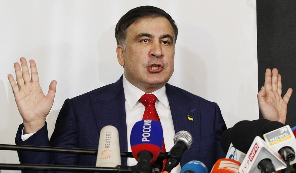 Mikheil Saakashvili, former Georgian president-turned-Ukrainian opposition leader, speaks to reporters in Warsaw, Poland, Tuesday, Feb. 13, 2018. Saak