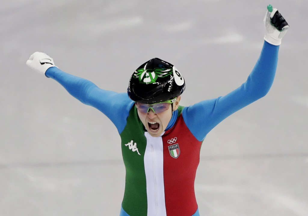 Arianna Fontana of Italy reacts as she crosses the finish line to win the ladies' 500 meters short track speedskating final in the Gangneung Ice Arena