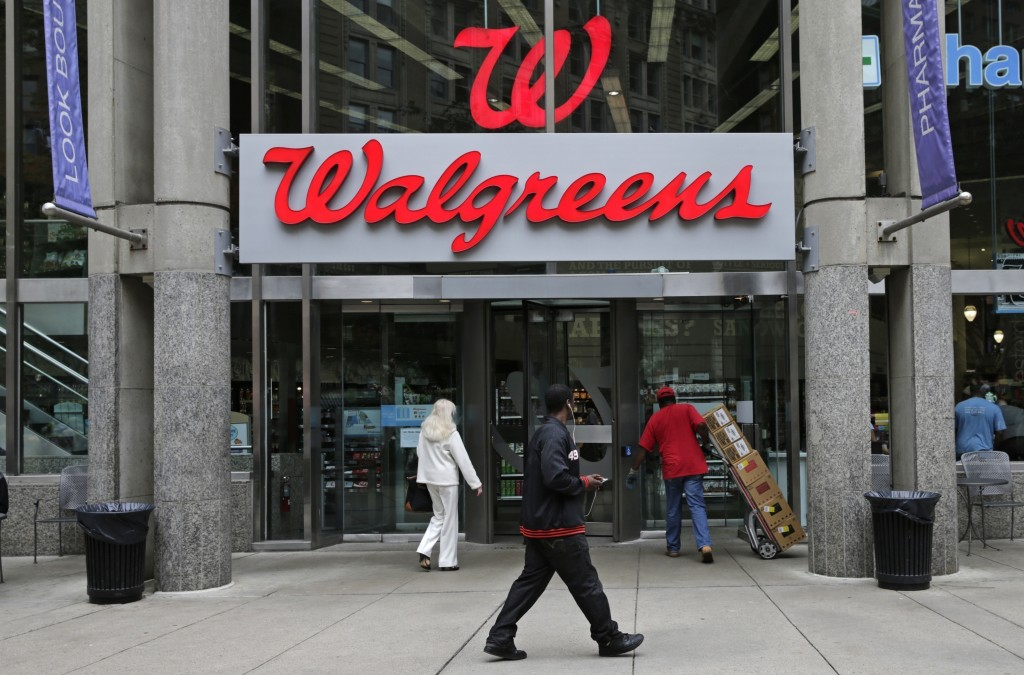 FILE - This June 4, 2014, file photo, shows a Walgreens retail store in Boston. Shares of AmerisourceBergen are soaring before the opening bell, Tuesd