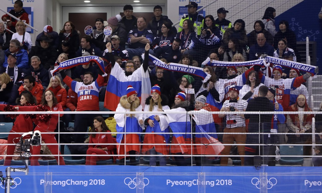Fans cheer for Olympic athletes from Russia during the third period of the preliminary round of the women's hockey game between the United States and