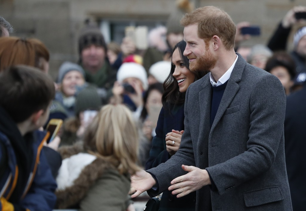 Britain's Prince Harry and his fiancee Meghan Markle arrive at Edinburgh Castle in Edinburgh, Scotland, Tuesday, Feb. 13, 2018. The recently engaged c