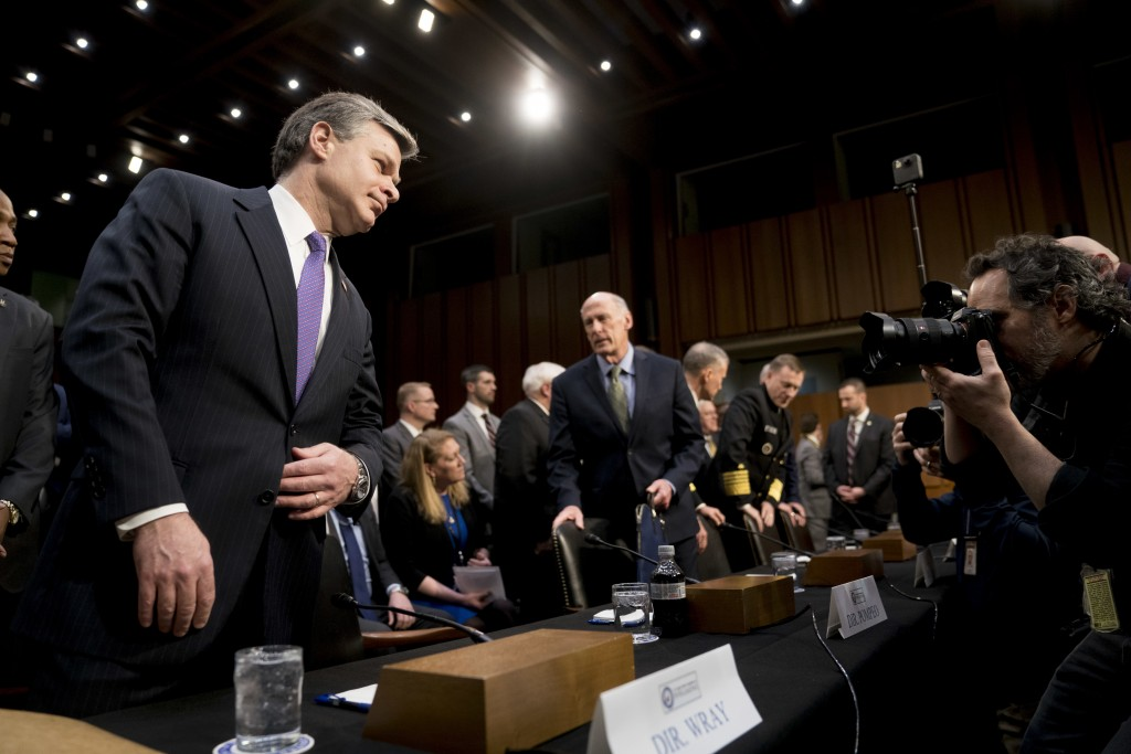 FBI Director Christopher Wray, left, and Director of National Intelligence Dan Coats, center, arrive for a Senate Select Committee on Intelligence hea