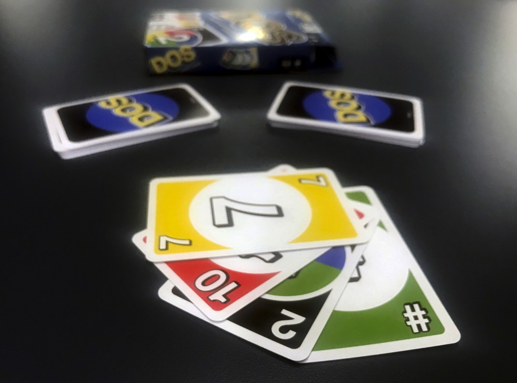 Mattel's new card game Dos is displayed on Monday, Feb. 12, 2018, in New York. Mattel is launching the new card game next month in hopes of giving its