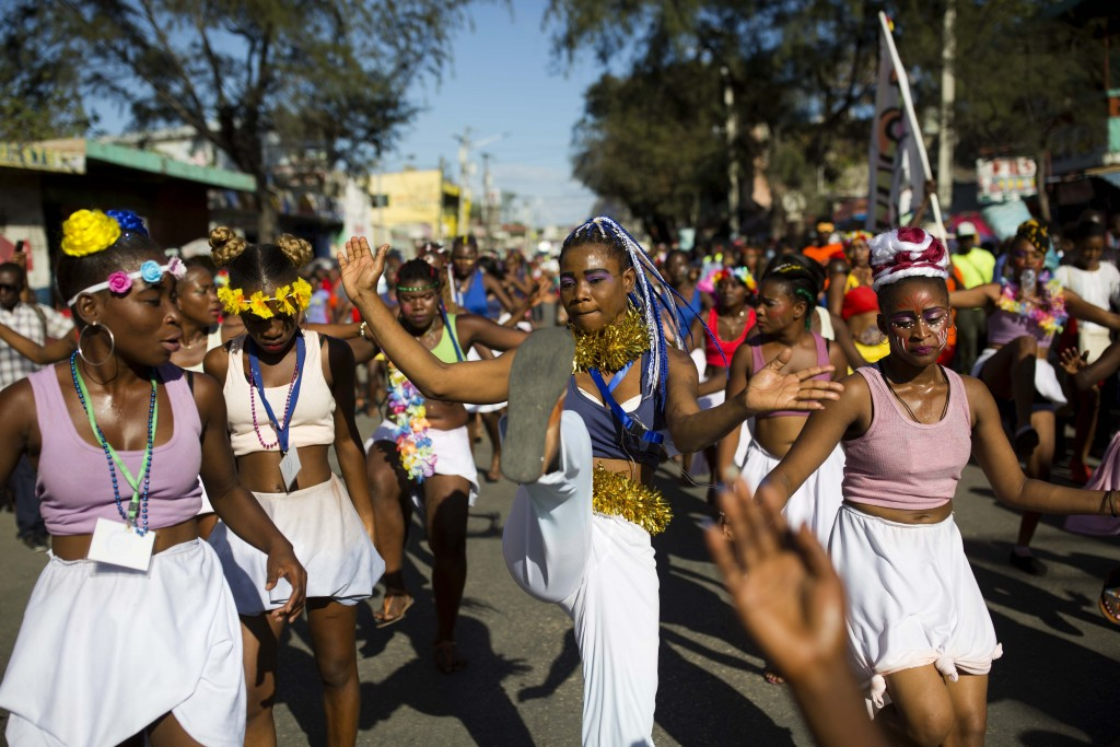 Dancers perform during a Carnival parade in Port-au-Prince, Haiti, Monday, Feb. 12, 2018. (AP Photo/Dieu Nalio Chery)