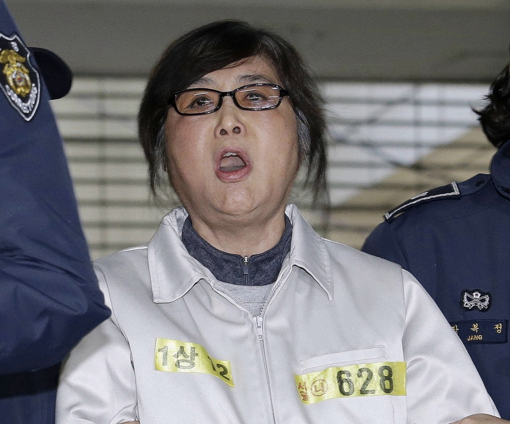 FILE - In this Jan. 25, 2017, file photo, Choi Soon-sil, the jailed confidante of impeached South Korean President Park Geun-hye, shouts upon her arri...