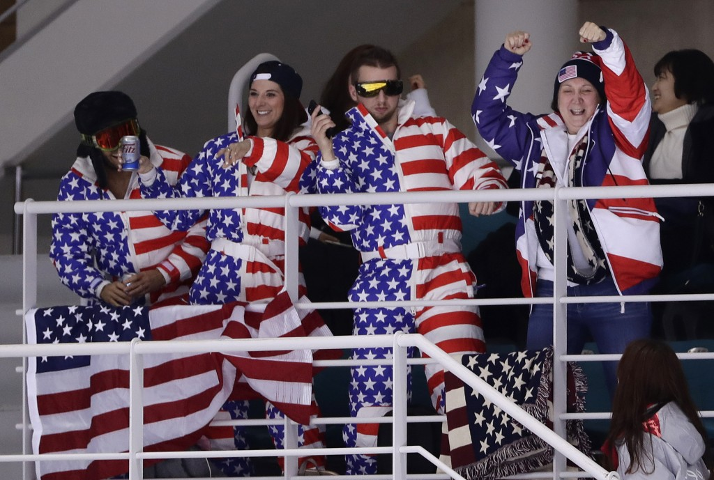Fans cheer during the second period of the preliminary round of the women's hockey game between the United States and the team from Russia at the 2018