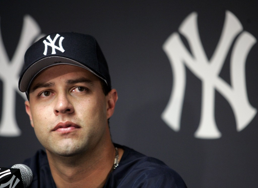 FILE - In this Aug. 1, 2004, file photo, New York Yankees pitcher Esteban Loaiza talks to reporters during a news conference at Yankee Stadium in New