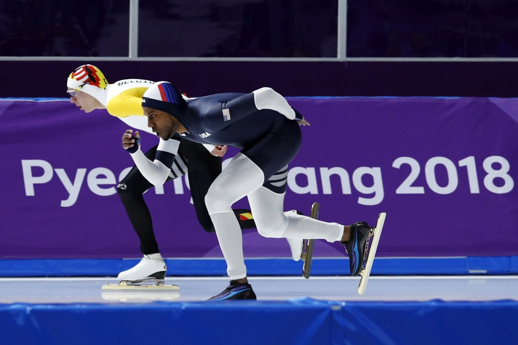 Shani Davis of the U.S., right, and Bart Swings of Belgium, left, compete during the men's 1,500 meters speedskating race at the Gangneung Oval at the