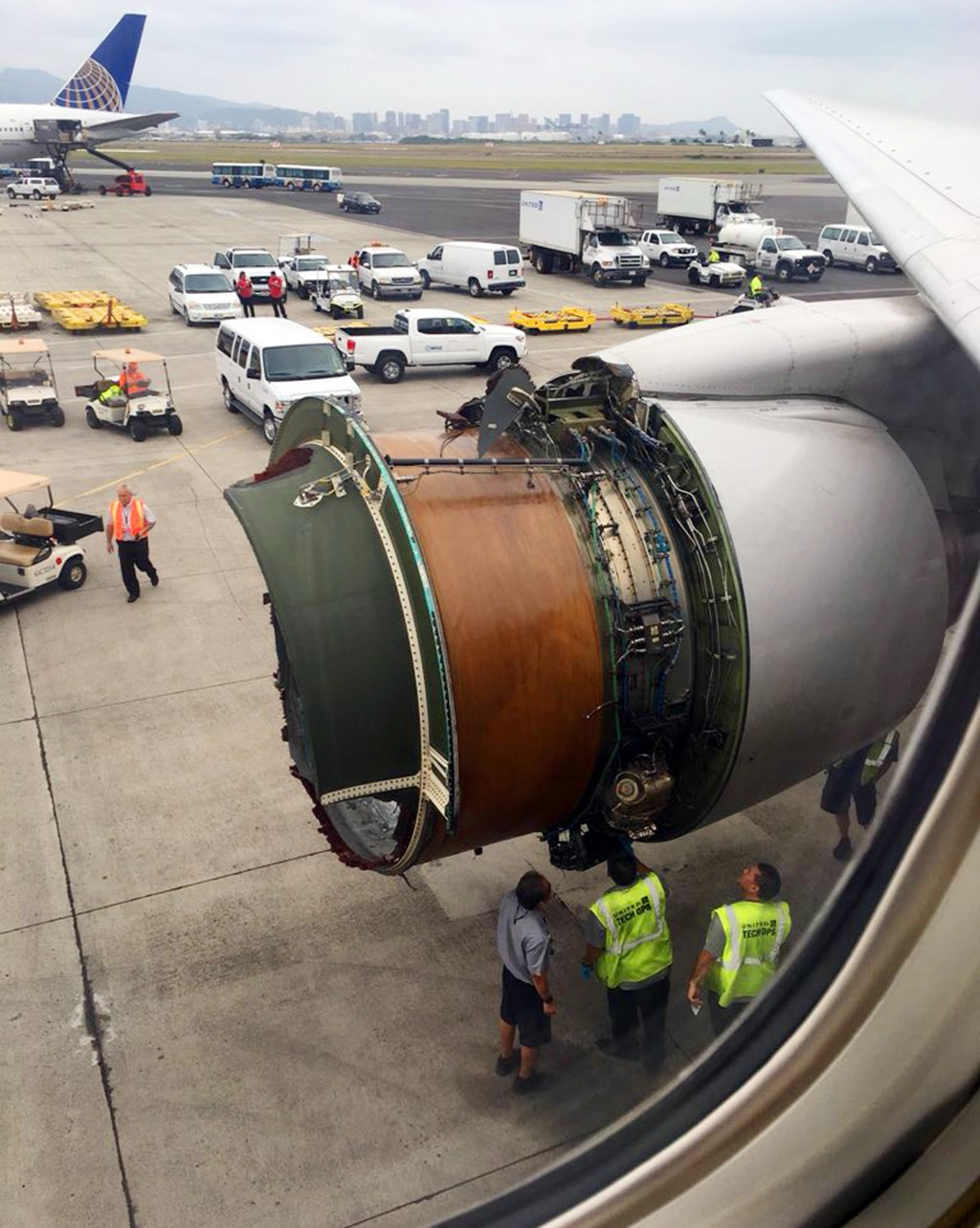 This photo provided by passenger Haley Ebert shows damage to an engine on what the FAA says is a Boeing 777 after parts came off the jetliner during i