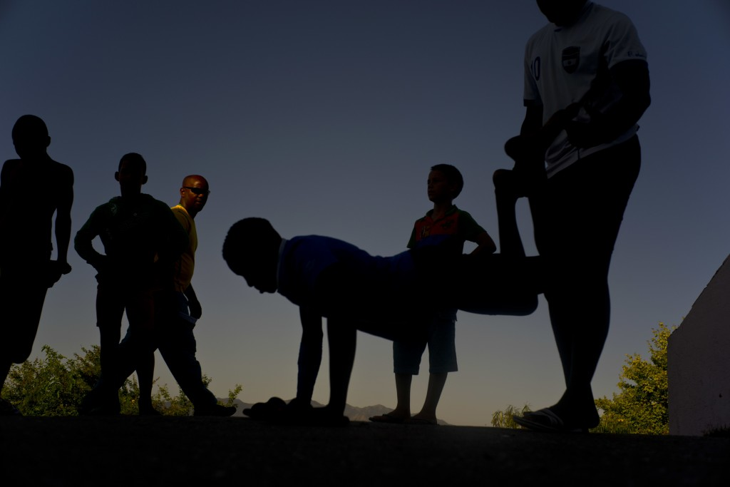 """In this Jan. 23, 2018 photo, young wrestlers train outside during the week-long student wrestling championship coined """"The truth of my neighborhood,"""""""
