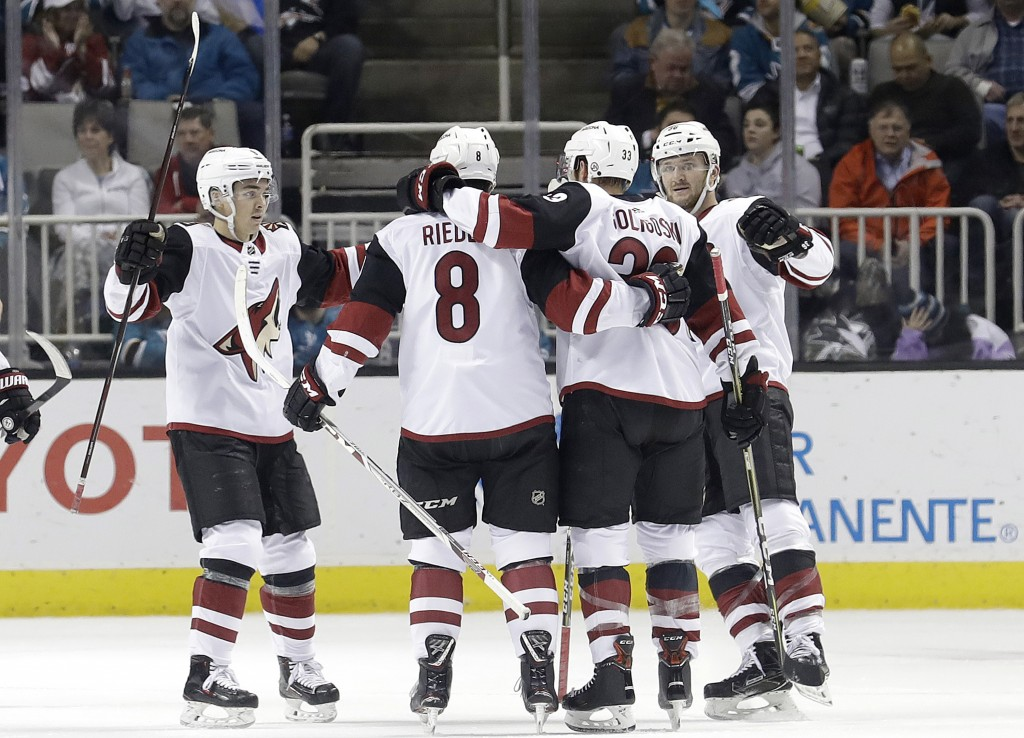 Arizona Coyotes defenseman Alex Goligoski, second from right, celebrates with teammates after scoring a goal against the San Jose Sharks during the se