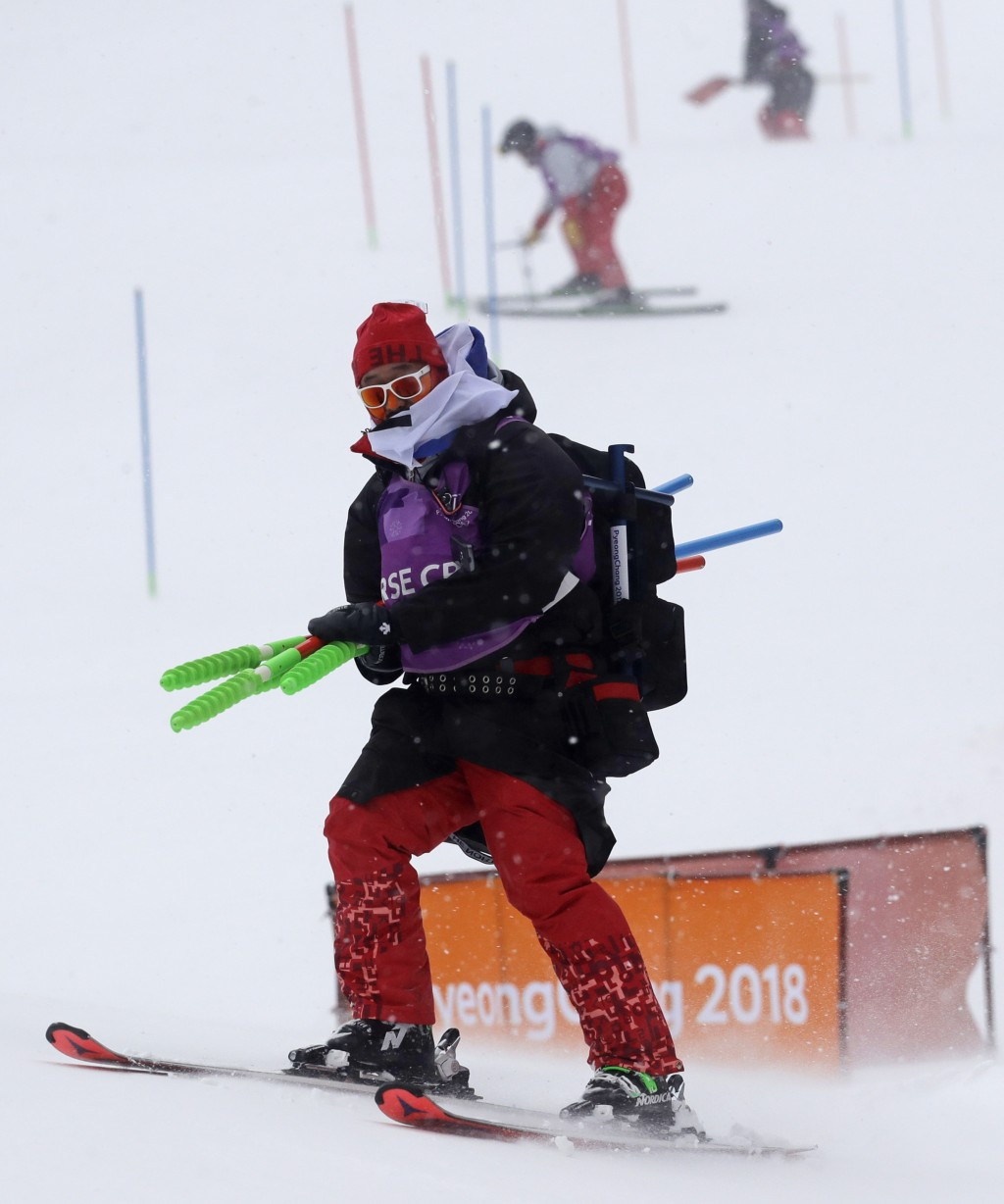 The course is dismantled after the women's slalom is canceled for the day due to weather at Yongpyong alpine center at the 2018 Winter Olympics in Pye