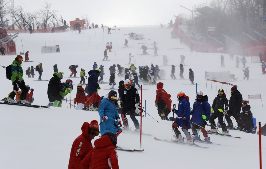 Skiers take part in an inspection of the course ahead of the women's slalom at Yongpyong alpine center at the 2018 Winter Olympics in Pyeongchang, Sou