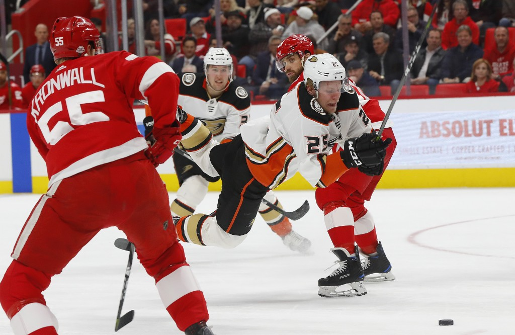 Anaheim Ducks' Ondrej Kase (25) loses the puck after tripping against the Detroit Red Wings in the first period of an NHL hockey game Tuesday, Feb. 13