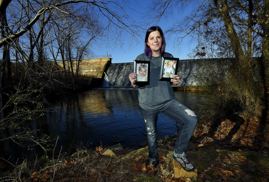 Sarah Sherbert poses for a photo in Anderson, S.C., on Monday, Feb. 5, 2018, holding photos of her children when they were infants. Sherbert, 31, said