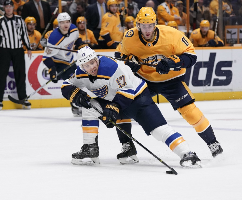 St. Louis Blues left wing Jaden Schwartz (17) holds onto the puck as Nashville Predators center Kyle Turris (8) looks for the steal in the second peri