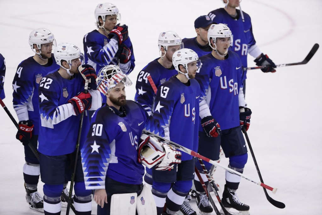 Goaltender Ryan Zapolski (30), of the United States, reacts with teammates after losing to Slovenia in the preliminary round of the men's hockey game
