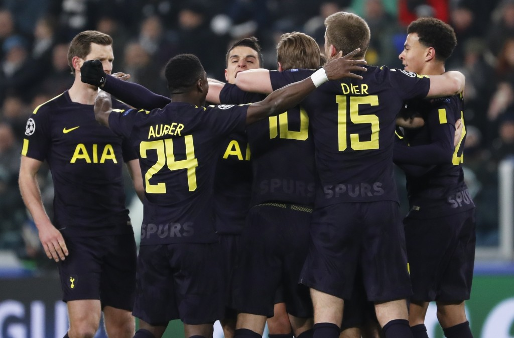 Tottenham players celebrate after Christian Eriksen scored during the Champions League, round of 16, first-leg soccer match between Juventus and Totte