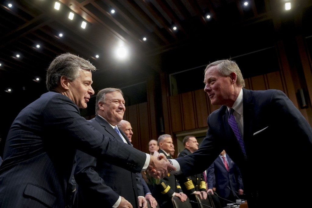 Chairman Richard Burr, R-N.C., right, greets FBI Director Christopher Wray, left, before a Senate Select Committee on Intelligence hearing on worldwid