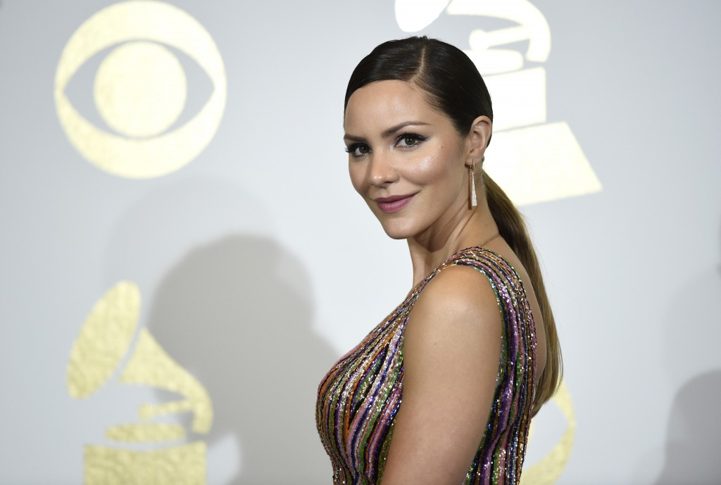 FILE - In this Feb. 12, 2017 file photo, singer and actress Katharine McPhee poses in the press room at the Grammy Awards in Los Angeles. McPhee, who