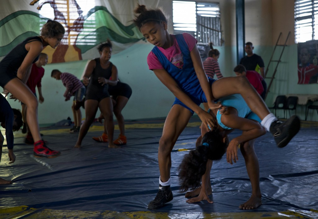 """In this Jan. 24, 2018 photo, young female wrestlers train at a gym for the week-long student wrestling championship coined """"The truth of my neighborho"""