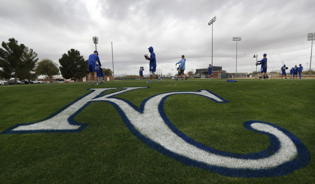 Kansas City Royals non-roster invitees warm up during a baseball spring training workout, Tuesday, Feb. 13, 2018, in Surprise, Ariz. (AP Photo/Charlie