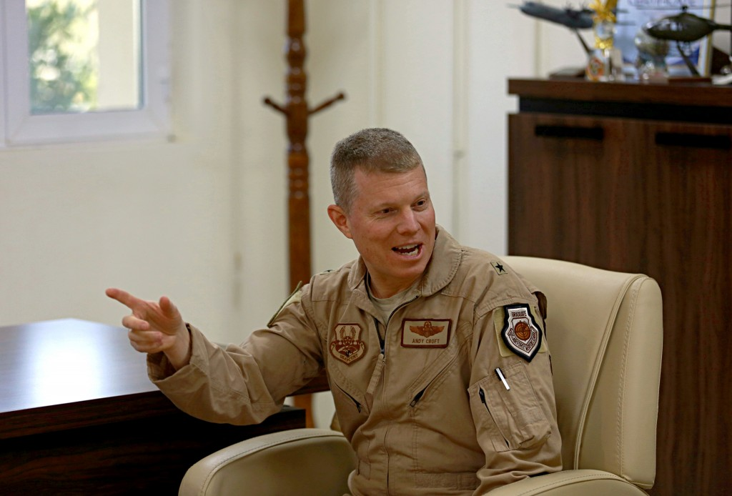 In this Sunday, Feb. 4, 2018 photo, U.S. Air Force Brig. Gen. Andrew Croft speaks to the commander of the Iraqi Air Force Gen. Anwar Hama Ameen during