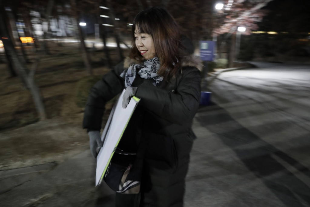 In a photo taken Monday, Feb. 12, 2018, Woo Hee-jun, mother of South Korean player Han Dohee, arrives at the Kwandong Hockey Center to watch her daugh