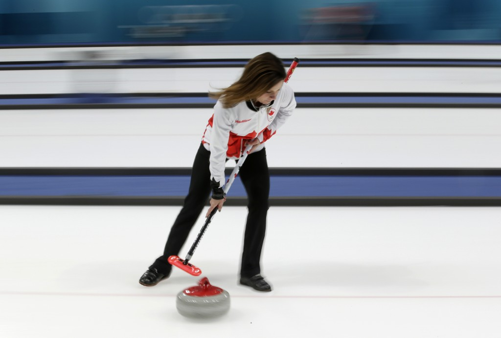 Canadian curler Cheryl Bernard sweeps ice during a training session for the women's curling matches at the 2018 Winter Olympics in Gangneung, South Ko