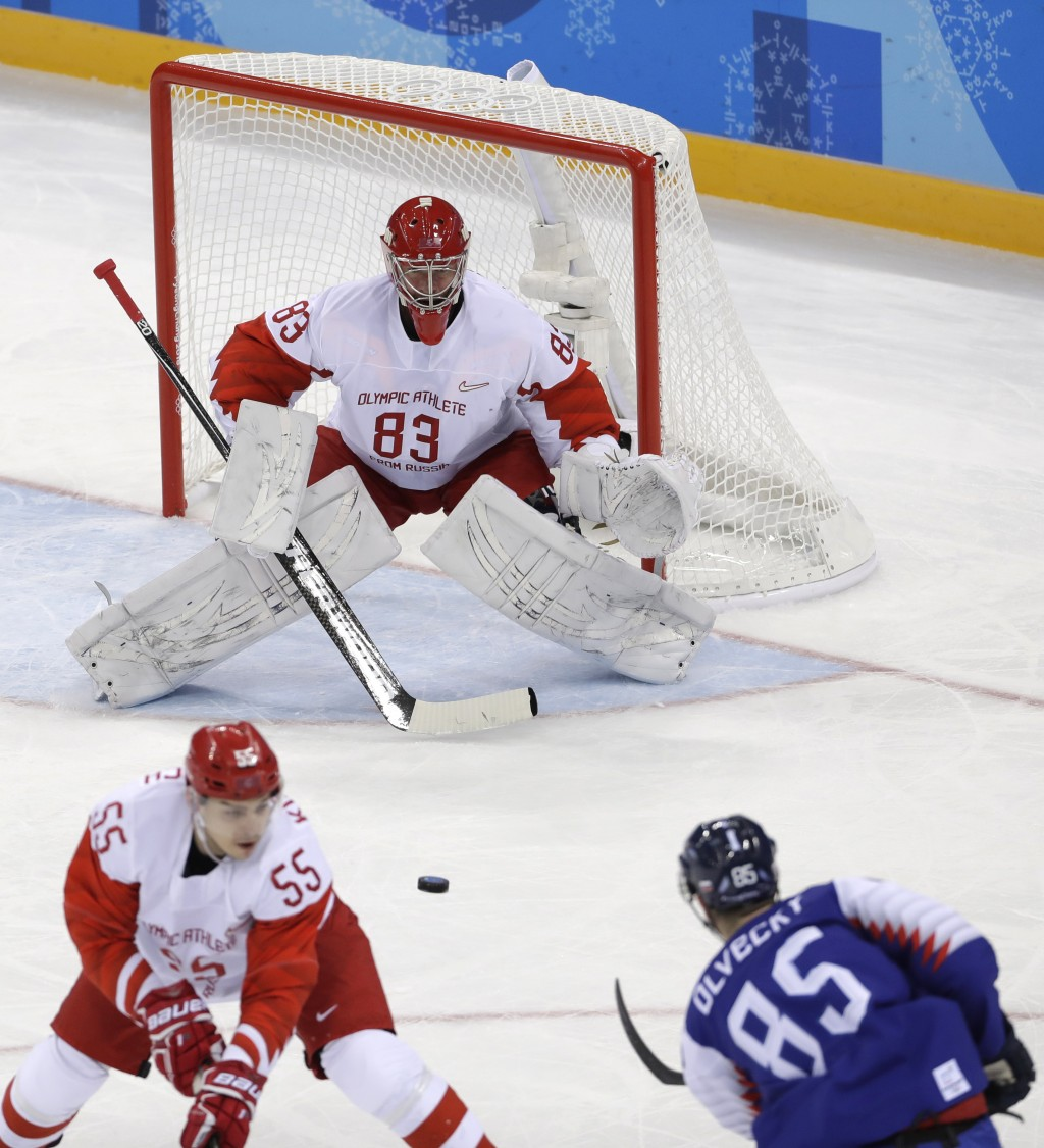 Peter Olvecky (85), of Slovakia, shoots a goal against Russian athlete Vasili Koshechkin (83) during the first period of the preliminary round of the