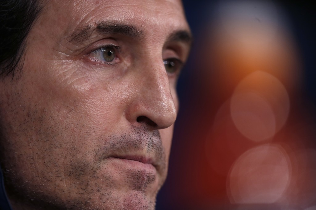 PSG's head coach Unai Emery listens to a question during a news conference at the Santiago Bernabeu stadium in Madrid, Tuesday, Feb. 13, 2018. Paris S
