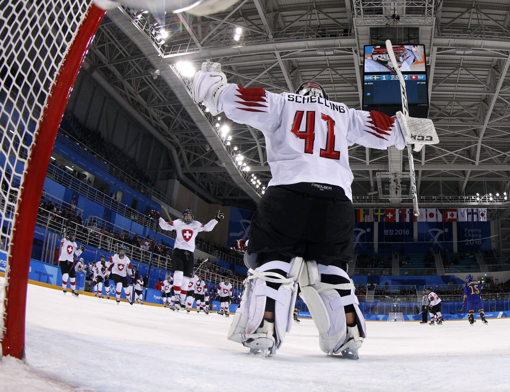 Players from Switzerland celebrate after the preliminary round of the women's hockey game Sweden at the 2018 Winter Olympics in Gangneung, South Korea