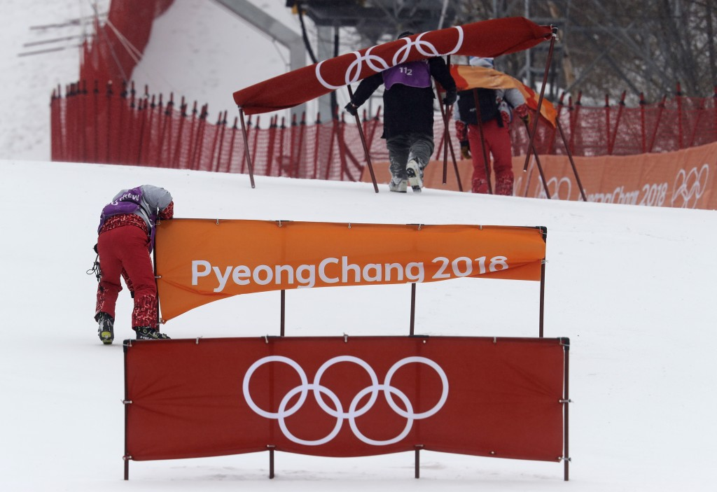 Members of the course crew dismantle it after the women's slalom was canceled for the day due to weather at Yongpyong alpine center at the 2018 Winter