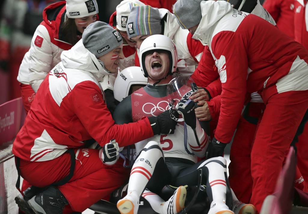 Georg Fischler and Peter Penz of Austria celebrate their silver medal winning run during the men's doubles luge final at the 2018 Winter Olympics in P