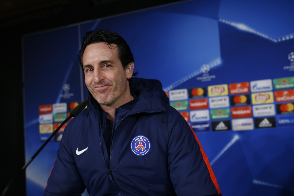PSG's head coach Unai Emery arrives to a news conference at the Santiago Bernabeu stadium in Madrid, Tuesday, Feb. 13, 2018. Paris Saint Germain will