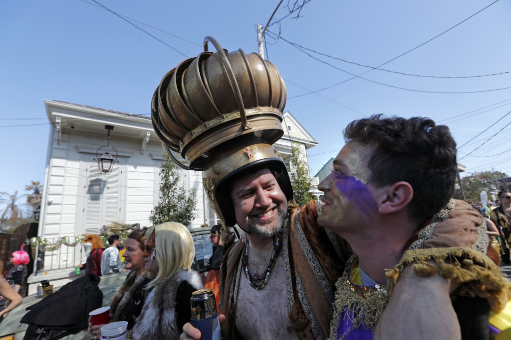 A man uses an attic vent as headgear during the Society de Sainte Anne parade, on Mardi Gras day in New Orleans, Tuesday, Feb. 13, 2018. (AP Photo/Ger