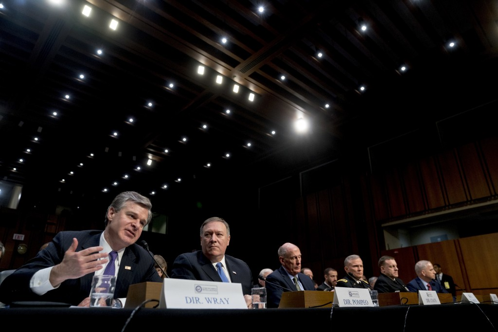 From left, FBI Director Christopher Wray, accompanied by CIA Director Mike Pompeo, Director of National Intelligence Dan Coats, Defense Intelligence A