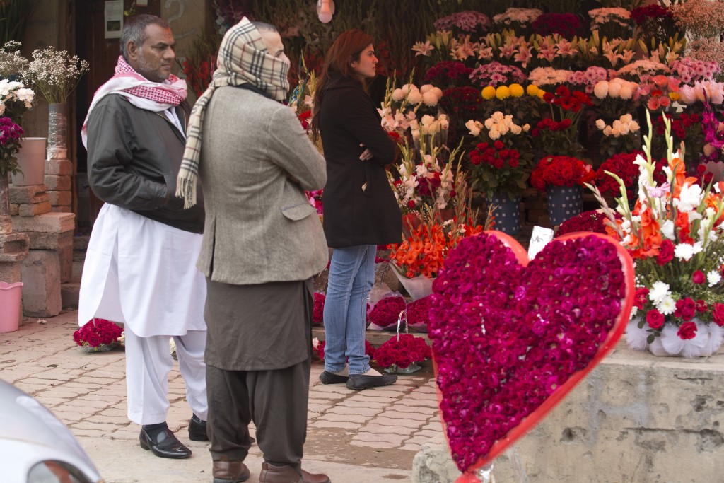 People buy flowers to celebrate the Valentine's Day in Islamabad, Pakistan, Wednesday, Feb. 14, 2018. Pakistan's media regulatory authority, acting on