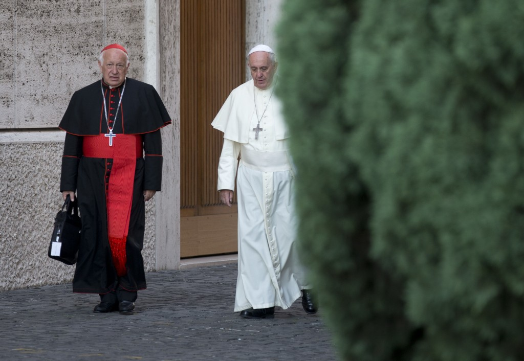 FILE - In this Oct. 9, 2014 file photo, Pope Francis, right, walks with Chile's Cardinal Ricardo Ezzati to a session of the synod, a two-week meeting