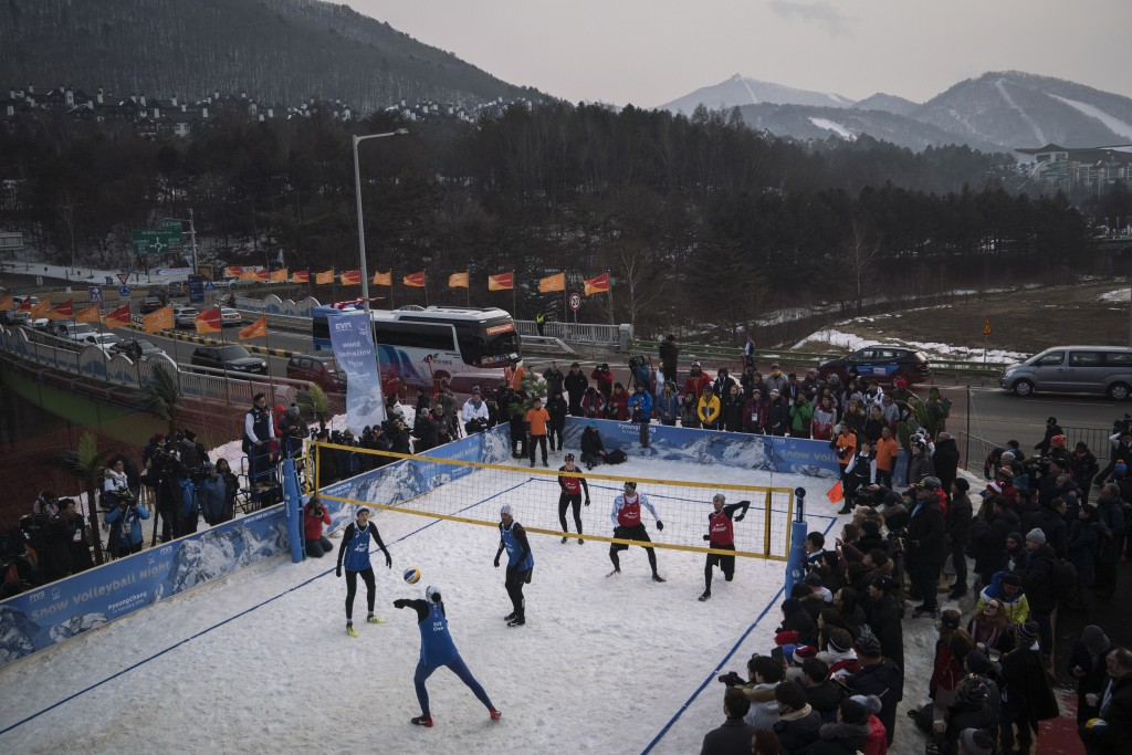 China's Xue Chen passes the ball during a snow volleyball exhibition match at the Austria House in Pyeongchang, South Korea, Wednesday, Feb. 14, 2018.