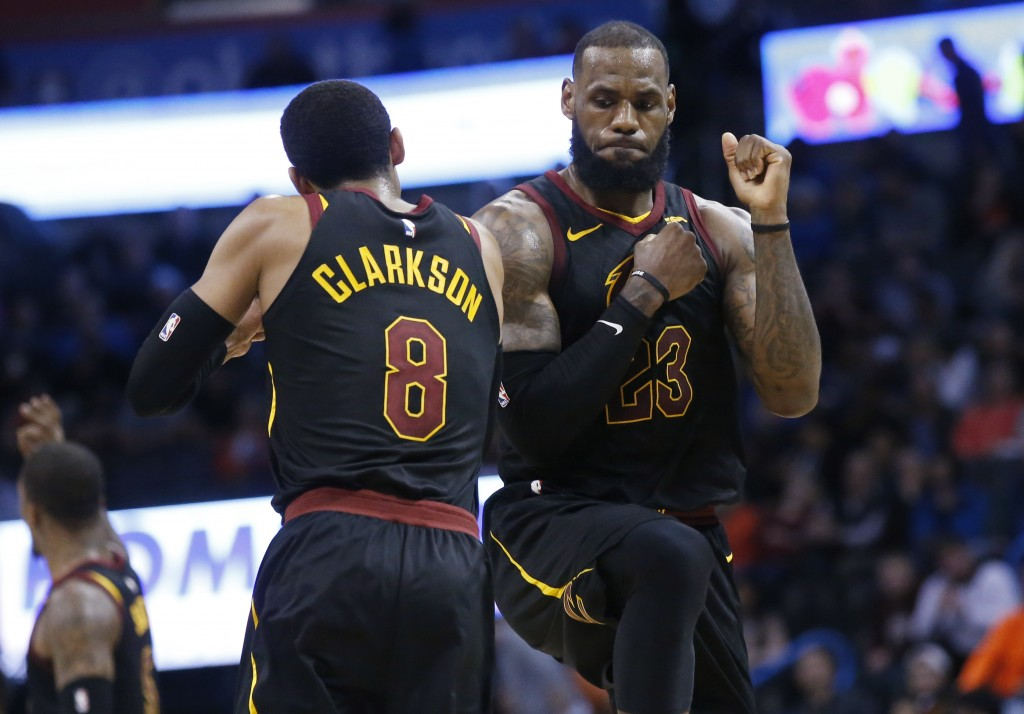 Cleveland Cavaliers forward LeBron James (23) celebrates with teammate Jordan Clarkson during the second half of the team's NBA basketball game agains