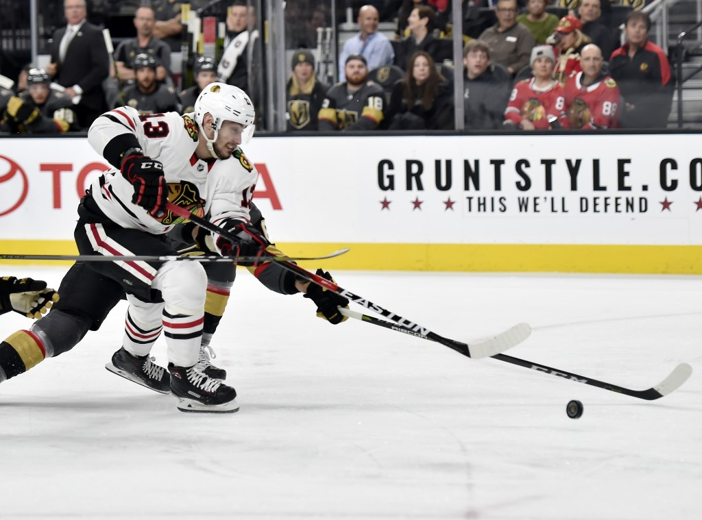 Chicago Blackhawks right wing Tomas Jurco skates with the puck against the Vegas Golden Knights during the first period of an NHL hockey game Tuesday,
