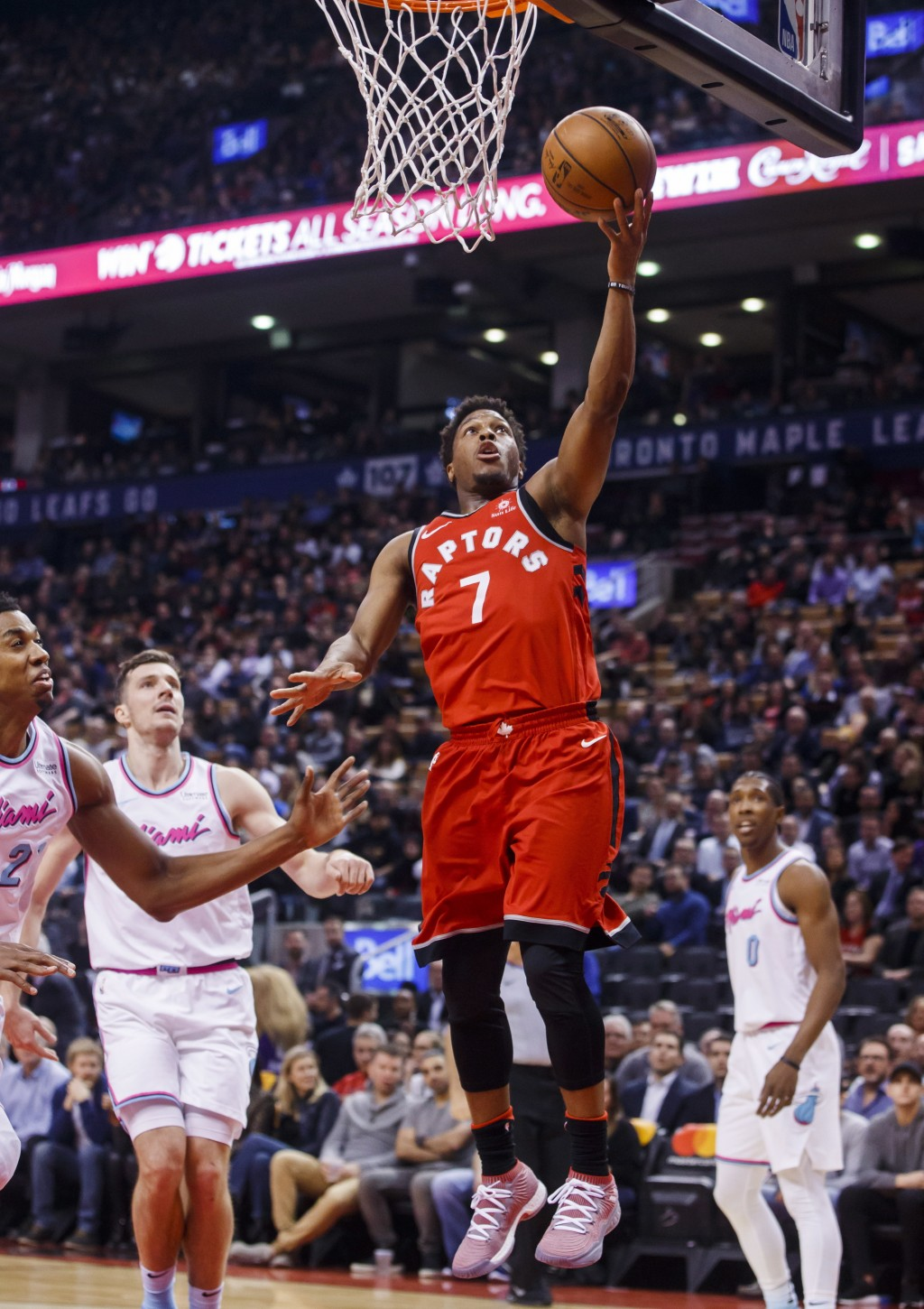 Toronto Raptors' guard Kyle Lowry goes to the basket against the Miami Heat during the first half of an NBA basketball game, Tuesday, Feb. 13, 2018, i