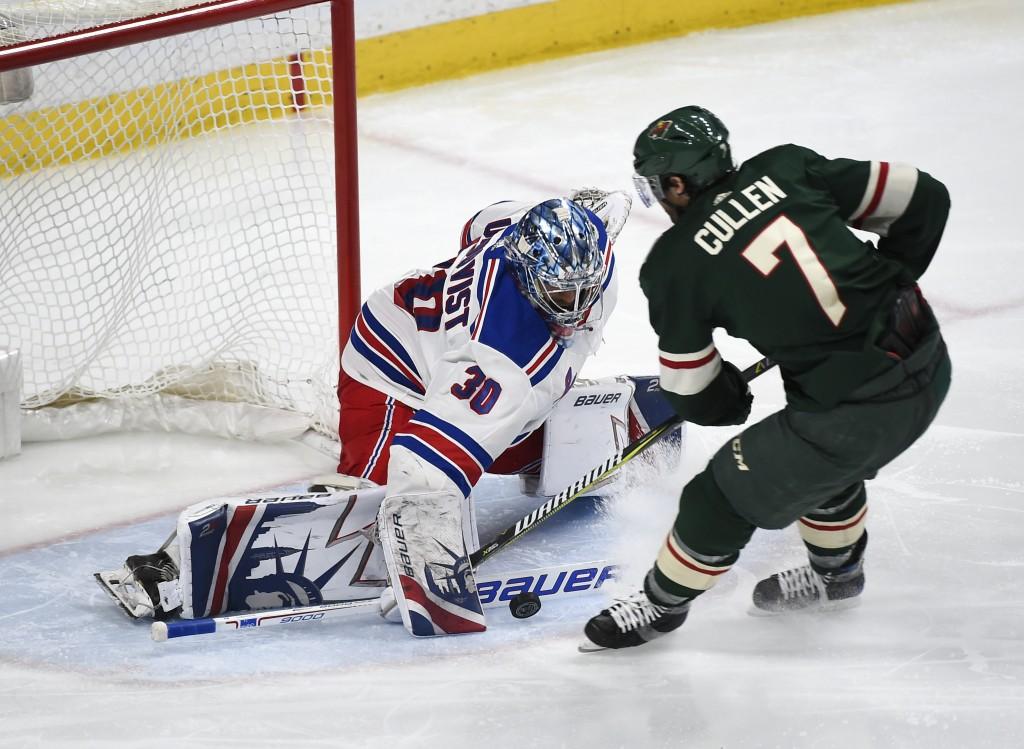 New York Rangers goalie Henrik Lundqvist (30), of Sweden, stops a shot by Minnesota Wild center Matt Cullen (7) during the third period of an NHL hock